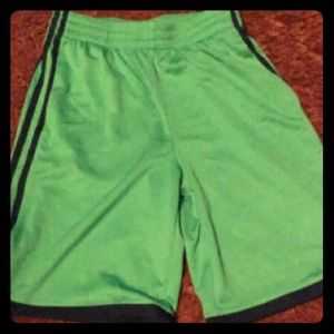 Green and navy blue adidas shorts